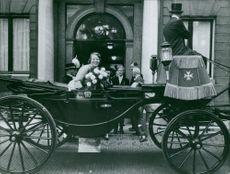 Beatrix of the Netherlands sitting in carriage.