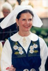 Portrait of Queen Silvia in the classic headdress of the national costume. The picture is taken in conjunction with the national celebration.