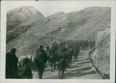 A group of people walking towards to the top of mountain during First World War, 1935.
