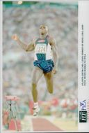 Carl Lewis jumps at the Atlanta Olympic Games in 1996