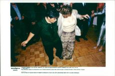 Diego Maradona releases along with Claudia Cardinale at the party after the fashion show by Roberto Giordano