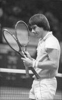 Jimmy Connors chooses the racket ahead of the match in the Wembley arena