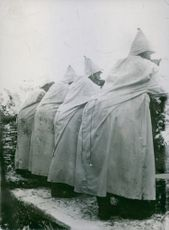 Soldiers standing while looking something and wearing a coat during Tyskland war.