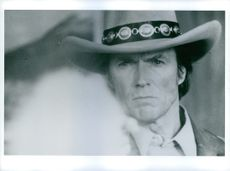 Clint Eastwood posing and looking towards the camera.