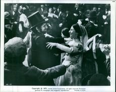 A scene of a woman and a man dancing together in the film, Fiddler on the Roof. 1971.