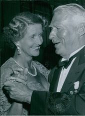 Prince Otto von Bismarck dancing with Queen Anne-Marie and smiling.
