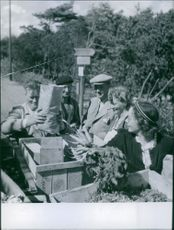 Men and women traveling by carrier.