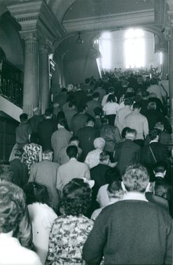 The crowd slowly walking on the stairs. July 15, 1954