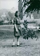Princess Margaret wearing the uniform of a Girl Guide, near the Frogmore Camp in Windsor Great Park, in June 1942.