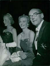 Anna Maria and Otto Christian Archibald Von Bismnarck is sitting while being photographed happily. 1956