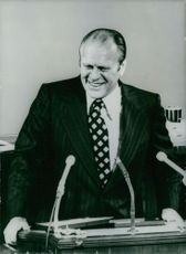 Gerald Rudolph Ford Jr. standing, smiling.