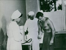 Medical workers doing a check-up on Vladimir Komarov.