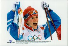 Russian Larissa Lazutina celebrates the gold medal in cross country skiing 5 km classical style.