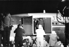 """Robert Francis """"Bobby"""" Kennedy`s family inside the plane carrying his body at the New York airport."""