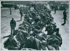 Indian Division captives being formed up to march to a collection center, 1943.