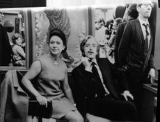Princess Margaretha sitting with a man beside her.