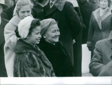 Nina Petrovna Khrushcheva smiling among the crowd.  - Nov 1959