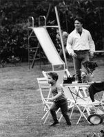 Jacques Charrier with his son, in a park.