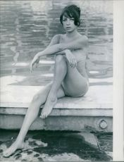 Marie Christine Barclay posing by the pool.