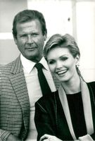 Portrait image of actors Roger Moore and Fiona Fullerton.