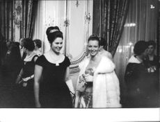 Marina Vlady with a woman in party, smiling.
