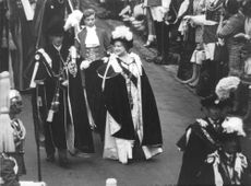 Prince Charles walking with the Queen mother, in formal dress.