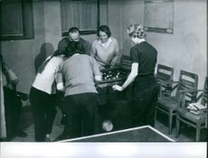 Princess Irene with friends are playing soccer table game.