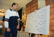Stefan Edberg looks at the match setting for the Eurocard Cup in 1995