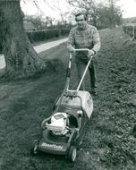 Denis Healey cut the lawn at his home in Sussex Down