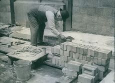Sir Harry Ralph Selley began laying bricks in the commons court, Westminster.
