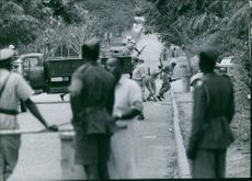 Soldiers coming off from vehicle.