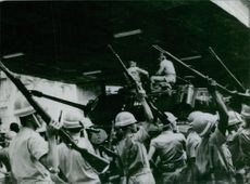 Soldiers holding gun and hand raised for war.