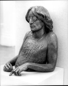 A statue by John Lennon made by Kenneth Carter