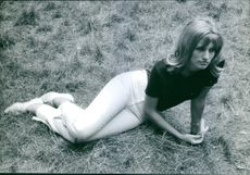 Anna Lena Wassbo sitting on the grassy ground. Photo taken on September 7, 1962.