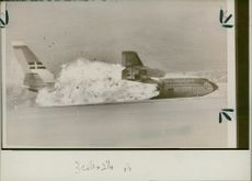 Flames engulfing the unmanned Boeing 720.