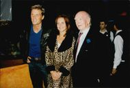 Portrait image of Dolph Lundgren and his unknown company, taken in connection with a visit to Planet Hollywood in Paris.