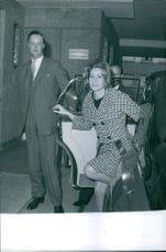 John Spencer-Churchill with a woman, looking towards the camera and smiling.