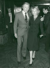 """Kirk Douglas along with his wife Anne comes out of """"Studio 54"""" in New York"""