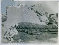 """A British soldier sleeping on a bed of live shells fortunately, he is only temporarily """"dead to the world""""."""