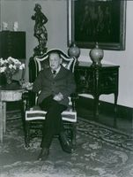 Somerset Maugham sitting on a chair. 1965.