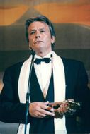 Actor Alain Delon receives a golden bear at the 45th International Film Festival in Berlin