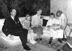 Albert II sitting on sofa with his family.