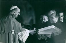 Pope Paul VI receiving the offering.