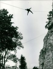 A man crossing with the help of rope.