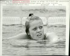 Gunilla Andersson breathes after swimming a 100-meter bronze bronze.
