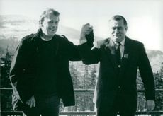 Vaclav Havel and Lech Walesa shake hands on the border between Czechoslovakia and Poland