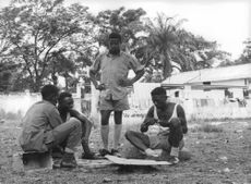 Soldiers relaxing in the field of Kongo.