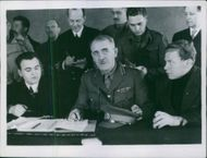 Resident Commissioner, Brigadier Potts, Russian Representative from London signing agreement of evacuation.