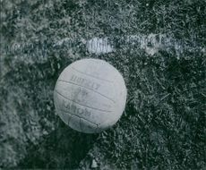 A football is on the ground. 1944