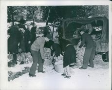 U.S. soldiers unload shoes for French needy at Le Havre